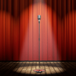 Comedy club stage with red curtain and microphone.